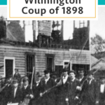 Image of men standing in front of ruins of the Daily Record newspaper after the Wilmington Coup of 1898